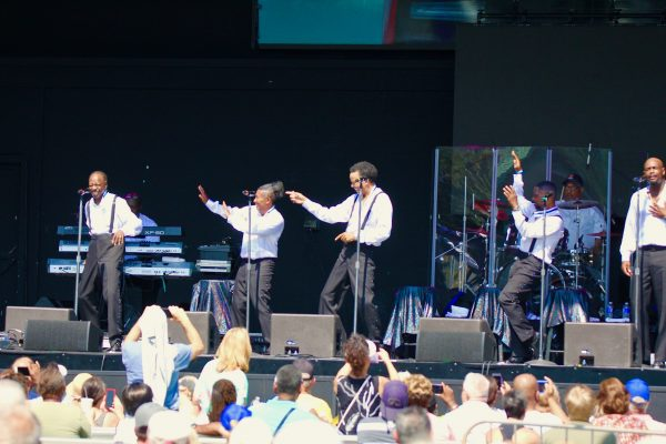 The Spinners having fun on stage while performing at the NY State Fair in August 2021